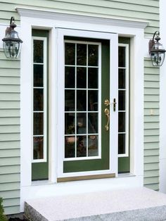 Your front door color doesn't have to be high-contrast to be beautiful, especially if your house is already a distinctive color. This door — painted in Behr's Tuscany Hillside — deepens the effect of the green siding without making the look too busy. Exterior Door Colors, Front Door Paint Colors, Painted Front Doors, Exterior Doors, Entry Doors, Front Entry, House Colors Exterior Green, Front Porch, Light Green House