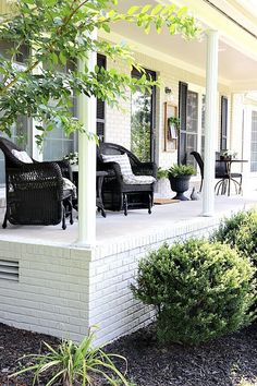 Limewash is always a beautiful choice if you're looking to update your brick. We've answered your top 14 questions about limewash, to make you a believer. Brick Porch, Concrete Porch, Brick Patios, Front Porch, Porch Swing, Brick Ranch Houses, White Brick Houses, Painted Brick Ranch, Porch Kits