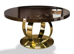 Comprising a glossy Macassar ebony top and a fabulous brass-plated base, Dom Edizioni's' Andrew Dining Table is bound to shine come supper time. Keep tableware neutral to let this piece do the talking. #LuxDeco #Design #Homeware