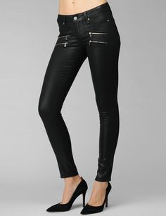 An ultra skinny body reworked with edgy double zippers below the front pockets. Front Rise: 8 1/8'; Inseam: 30'; Leg Opening: 10 1/4'; 42% Lyocell / 33% Cotton / 15% Rayon / 9% Polyester / 1% Spandex #Paige #Skinny #Black Silk