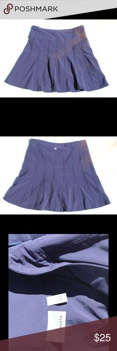 Athleta's Wear About Skort NAVY in color. Size 6. I've lost weight and not longer fits.  In excellent condition.  Still a very popular skort on Athleta's site.  This fits-everyone-perfectly skort takes to everything you do with built-in shorts and a shorter length for more active pursuits. INSPIRED FOR: adventure travel, golf, and more.Flat front waistband with side zip for easy on/off.BUILT-IN SHORTS. Eliminate the flash factor. Adjustable internal drawstring for a custom fit. Rear hidden…