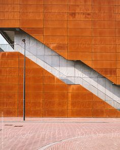 Modern building with rusty plates and stairs by Ivo de Bruijn #stocksy #realstock
