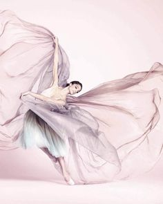 """Dorothée Gilbert (French, born 1983) dances with Paris Opera Ballet. Repetto was created in 1947 by Rose Repetto at the request of her son, famed dancer Roland Petit. Gilbert is photographed dancing in an ombre tutu and Repetto pointe shoes. Gilbert performed in 2012 as the principal dancer in Paris Opera's """"Giselle"""" at the New York City Ballet."""