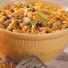Love taste of home!!!!!  Taco Salad.  I didn't add olives because I don't like them, but substituted a can of corn & a can of black beans.  I also used a full bag of cheese vs. a cup.  To keep things from getting soggy, I kept the meat/bean mixture in one container, the lettuce/cheese in another, and the rest of the ingredients in 3rd container.