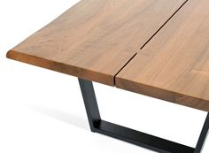 Modern design with minimal decoration evokes the design icon George Nakashima. Extra thick Walnut slabs are joined by exposed butterfly joints. Freeform edge celebrates the organic quality of the wood
