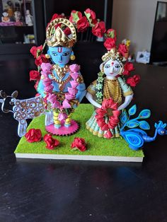 Spiritual and eternal couple Radha and Krishna with cow and peacock in a beautiful setting. Made with paper and wood. Height: 4 please note: this paper figurine is not a toy for young children.