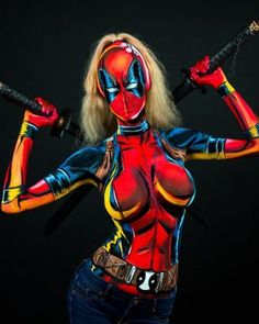 Canadian-based cosplayer Kay Pike incredibly turns herself into superheroes like Lady Deadpool, Robin, and more with just body paint. Lady Deadpool, Batgirl, Catwoman, Superhero Cosplay, Marvel Cosplay, Anime Cosplay, Dead Pool, Woman Painting, Artist Painting