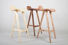 Trio of Saddleback Stools, Phoebe Everill  Huon Pine, Victorian Blackwood, New Zealand Cheerbeech ∙ 2011 An exhibition piece with Coopered Seats with extensive handshaping.