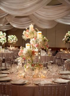 Elegant floral centerpiece with candles.