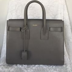 Yves Saint Laurent | Sac De Jour Brand new. Purchased in January of this year. Worn a handful of times. Always kept in is dust bag. (Which is included). Comes with strap. All reasonable offers are considered. More pictures upon request. Yves Saint Laurent Bags