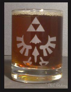 The Glass Geek. • Finished a couple of Legend of Zelda shot glasses...Royal Seal of Hyrule
