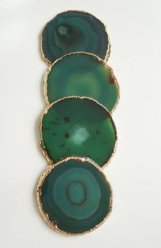 you will receive a SIMILAR set as the ones in the photos  // Brazilian Agate coasters sets //  ► Green agate coasters are a lovely forest green with light green and emerald tones. For the most part these are evenly colored. Brazilian Agate is unique in color and exhibits natural marbling. Some even have crystals! The edges of each piece are electroplated with a beautiful metallic SILVER or GOLD. Each coaster comes with small, clear rubber feet on the bottoms to keep the ag...