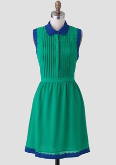This charming emerald green dress is crafted in a textured fabric and features a bright blue colorblocked collar and hem. Perfected with a scalloped edge and pintuck detailing at the bodice and a...