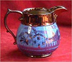Large copper lustre pitcher.