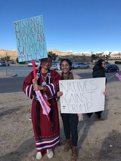 """""""Missing: Murdered Indian Women #MMIW (Missing and Murdered Indigenous Women),"""" Two protesters (Heather Kae on left) stand with placards at a rally sponsored by Indivisible Morongo Basin; the Women's March, January 20, 2018 - Yucca Valley, California. Photo credit: Does anyone know who took this picture?"""