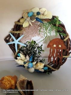 Beach wreath with lazer cut jelly fish and seashells_beach decor by CarmelasCoastalCraft on Etsy