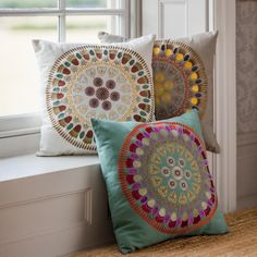 Mandala patterned embroidered cushions available in a choice of three colourways…
