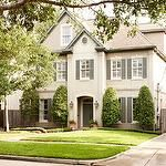 BHG - home exteriors - modern cottage homes, gray green shutters, gray green front doors, lanterns flanking entrance, lanterns flanking home entrance, covered entrance, two and a half story house, two and a half story home, well manicured lawns,