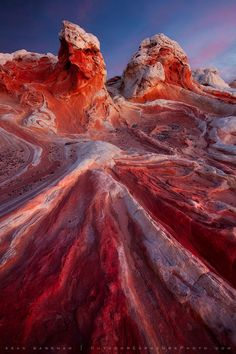 Forces of Time by Sean Bagshaw     Sandstone is nature's art medium. Formed in layers and sculpted by the elements, it comes in every shape and color. In the Vermilion Cliffs of southern Utah and northern Arizona, ancient winds created large sand dunes of alternating layers. Gravity and water caused them to flow and bend, creating swirls and folds like cream in coffee. The dunes eventually petrified. Now the forces of erosion are revealing the amazing patterns hidden within.