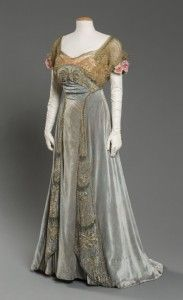 """Evening Dress, Fox, Paris or New York, about 1909 Light aqua silk velvet with peach silk satin, metallic lace and beadwork, and silk flowers  With its interplay of reflective materials, this romantic evening dress characterizes the close of La Belle Époque, the """"beautiful era"""" during which the arts flourished in Paris. The owner of the dress was a woman of cultivated taste, most likely Jane Taft Ingalls, the niece of President William Howard Taft."""