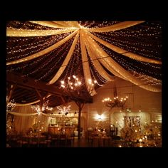Fearrington barn with stunning lights and drapes from the ceiling