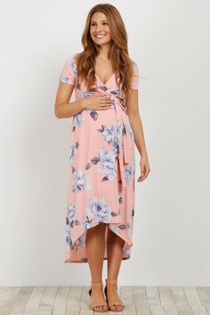 Florals are a staple for this season and this maternity wrap dress is a necessity. This dress features a trendy hi-low hemline and a wrap style that is perfect for nursing. Style this dress with your wedges and a statement necklace for a complete look.