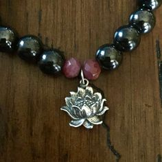 Magnetite Ruby Bracelet With Sterling Lotus FLower by TheModernMilagro on Etsy (that's me!0 Use code PINTEREST20 for a 20% discount on your purchase.