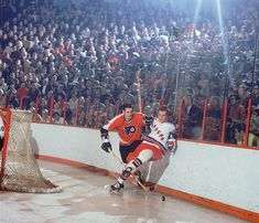 A colorized picture from a Flyers Rangers game in the 70's