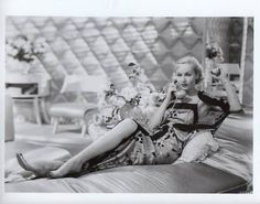 Carole Lombard leggy in bed