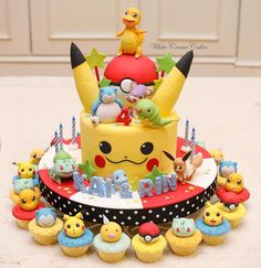 Pokemon cake & cupcakes for Kai & Rin🎉🎉🎉 . Pokemon Cupcakes, Pokemon Torte, Bolo Pikachu, Pikachu Cake, Pikachu Pikachu, Pokemon Themed Party, Pokemon Birthday Cake, 7th Birthday, Pjmask Party