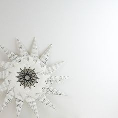 origami star = recycled paper + string