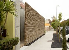 Reclaimed wood stacked up into a very cool privacy wall.