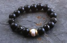 Check out this item in my Etsy shop https://www.etsy.com/listing/240577298/mens-bracelet-black-bracelet-onyx-and