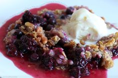 blackberry, blueberry and raspberry crisp with pine nut crumble topping and vanilla ice cream