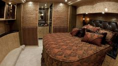 This is the master bedroom of the 2012 H3-45 Quad Slide designed by Millennium Luxury Coaches.