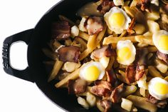 The Ultimate Breakfast Poutine: Fries, Crispy Quail Eggs, Cheese Curds and Bacon Gravy