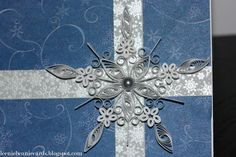 Here's a quilled snowflake for