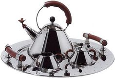 Michael Graves' classic Stainless Steel Tea Service Set which includes a tea kettle, creamer and sugar bowl, spoon, and tray. Absolutely beautiful.