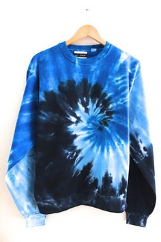 Shades of blue tie-dye swirl crew neck sweatshirt.  Made from 80% cotton and 20% polyester.Since each hoodie is hand-dyed, color blending will vary slightly making each one unique.Washing instructions:  Machine wash inside out in very ...