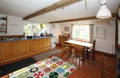 The kitchen is big, with a wood burning stove and a table that seats 10 (not the one pictured here!)