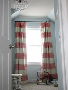 I love these red and white striped silk drapes, great in a boys room