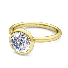 Bezet Solitaire Diamond Ring in 18k White or Yellow Gold G, SI2, 0.50 cttw. This diamond engagement ring features a brilliant diamond bezel set in 18k white gold or yellow gold. Perfect match diamond wedding band is available as a bridal set.