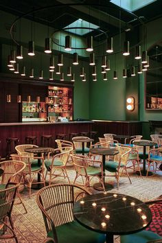 'Casa Bonay' Boutique Hotel Opens in Barcelona | Yellowtrace. Dark Green, cane chairs