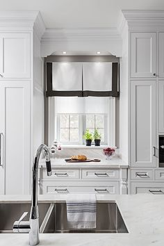 Stainless steel kitchen faucet and white marble countertop
