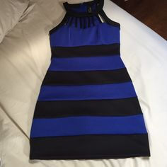 Blue and black striped dress Blue and black striped dress. Formfitting and never worn. Dresses