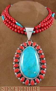 sterling pendant inlaid with natural red coal and large turquoise on a three strand coral and turquoise bead necklace.