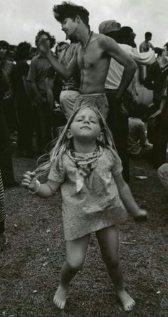 Scene from Woodstock. What I'd give to be that little gal.
