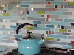 This fun #susanjablon #backsplash adds just the right pop of #color to this…