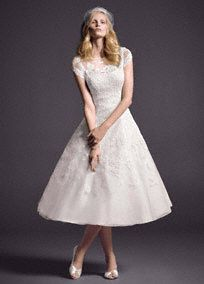 Take short and sweet to a whole new level in this lace cap sleeve tea-length wedding gown. Picture perfect for an outdoor wedding or reception dress. Short gown features illusion neckline and beaded lace appliques. No train. Sizes 0-14. Available online and in stores in Ivory. Available for special order in White. Fully lined. Back zip. Imported. Dry clean only. Woman: 8CMK513, Sizes 16W-26W (Special order only), $800 .