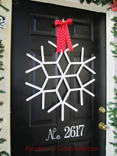 Giant craft stick snowflakes Supplies and tools • craft sticks •protractor • hot glue gun and glue • fishing line • clear cellophane tape • 3/8- to 1/2-inch-wide holiday ribbon • red and white paint (I used Benjamin Moore Aura Steam [AF-15] and Caliente [AF-290]) • round 12mm rhinestones • scissors • double-stick foam tape • small paintbrush •drop cloth or newspaper
